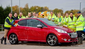 PEUGEOT DIRECTORS WASH CARS FOR CHILDREN IN NEED